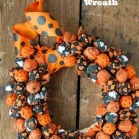 DIY Halloween Wreath that's a decoration & a Trick or Treat surprise.